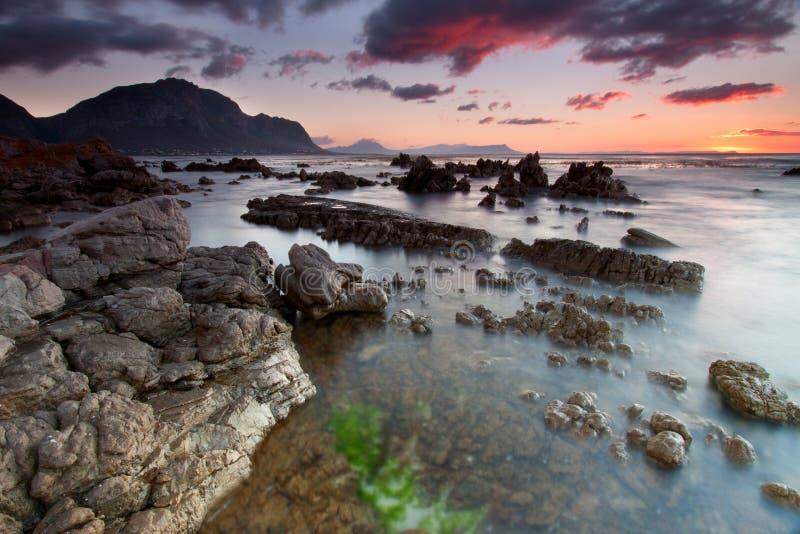 Download Bettys Bay Sunrise stock photo. Image of rocks, water - 12546932