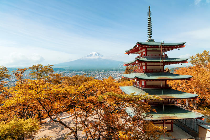 Beuatiful autumn in Japan at Red pagoda with Mt. Fuji royalty free stock photography