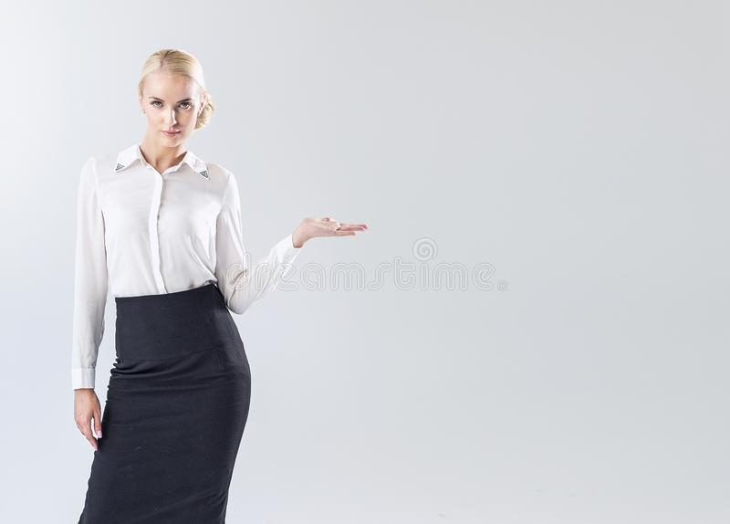 Beuatiful businesswoman indicating something - commercial concept royalty free stock photo