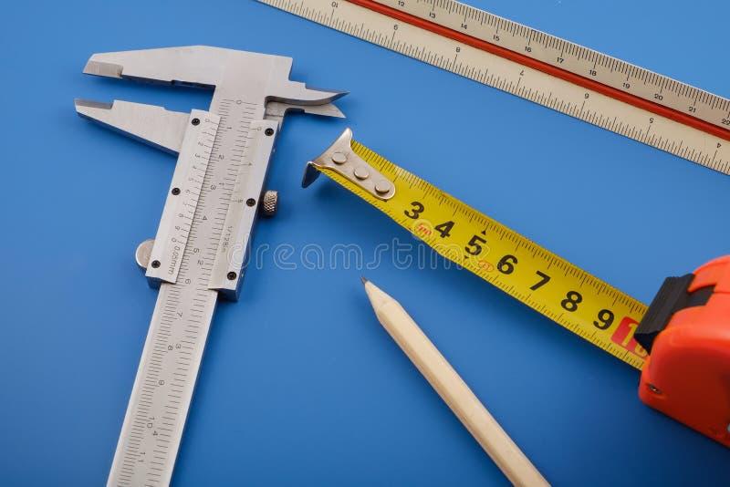 Beugel, heerser en het meten van band stock afbeelding