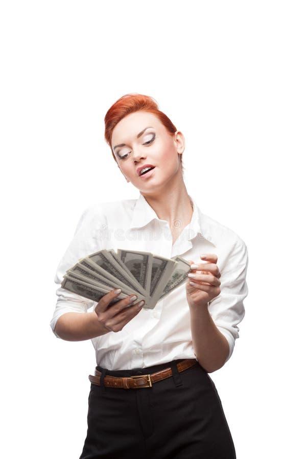 Beundra affärskvinnan som räknar pengar royaltyfria bilder