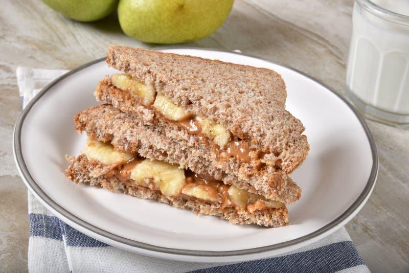 Beurre d'arachide et sandwich à banane images stock