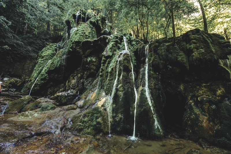 Beusnita Waterfall. A mistic waterfall in the deepest woods of Romania, sublime and moody colors gives this waterfall a unique view stock photo