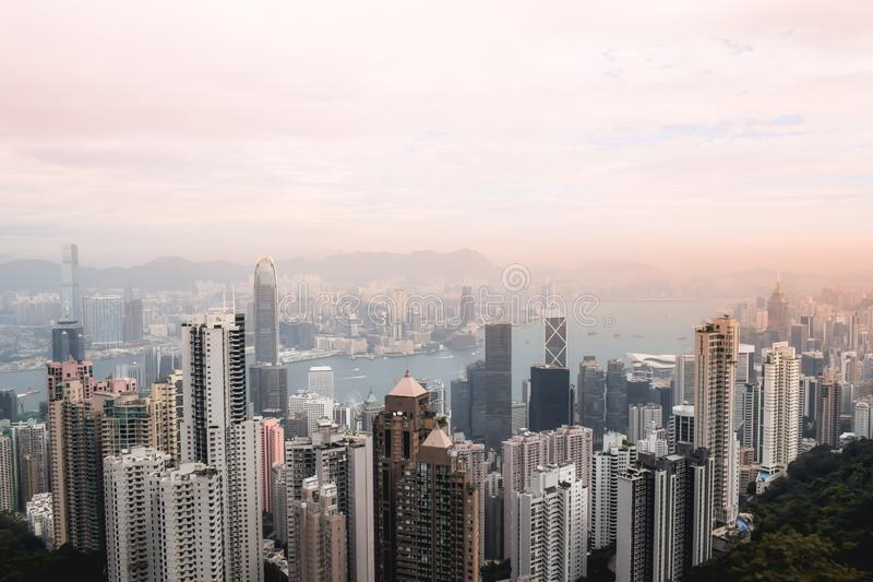 Beutiful pink sunset view on the Hong Kong skyline from the Peak stock photography