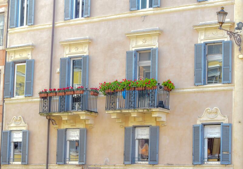 Beutiful windows with the flovers in Roma Italy. In February 2020 royalty free stock photo