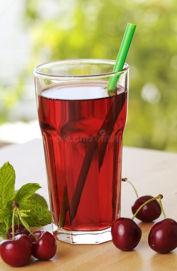 Bevanda della spremuta della ciliegia fotografia stock