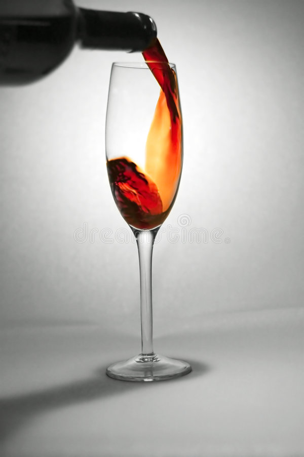 Beverage: Red Wine. Pouring red wine royalty free stock photo