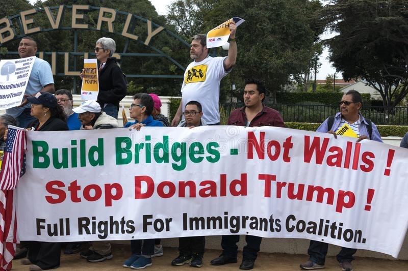 Build Bridges Not Walls Sign. BEVERLY HILLS, CALIFORNIA - MARCH 12, 2018: Defend Dreamers Rally hosted by Coalition for Humane Immigrant Rights CHIRLA royalty free stock image