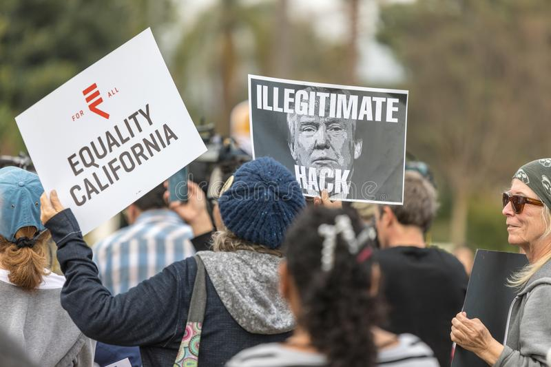 Illegitamate Hack sign with photo of Trump. BEVERLY HILLS, CALIFORNIA - MARCH 12, 2018: Protester holds a sign with a photo of President Trump with the words, ` royalty free stock photography