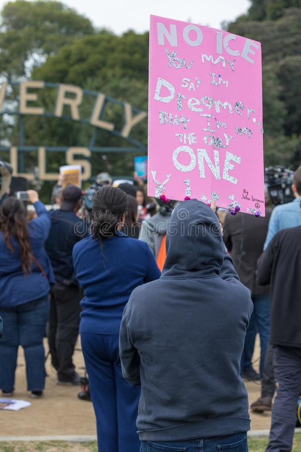 You may say I`m a dreamer sign held by protester. BEVERLY HILLS, CALIFORNIA - MARCH 12, 2018: A Protester holds a sign that reads `You may say I`m a dreamer` at royalty free stock photo
