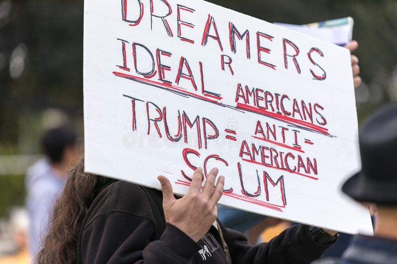 A protester holds sign Dreamers r ideal Americans. BEVERLY HILLS, CALIFORNIA - MARCH 12, 2018: Sign that reads, `Dreamers R Ideal Americans. Trump equals Anti royalty free stock image