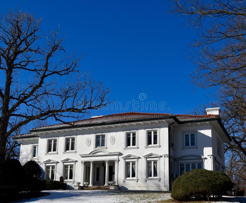 Beverly Italianate. This is a Winter picture of a house under a blue sky located in the Beverly neighborhood of Chicago, Illinois. This house built in 1905 is an royalty free stock photography