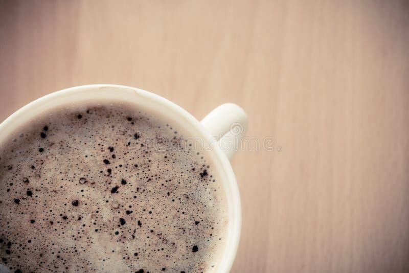 beverly Kopp av varmt drinkkaffe med fradga fotografering för bildbyråer