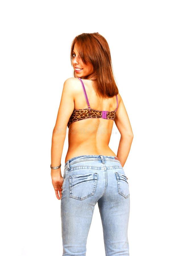 Bevindende vrouw in bustehouder en jeans. royalty-vrije stock afbeelding