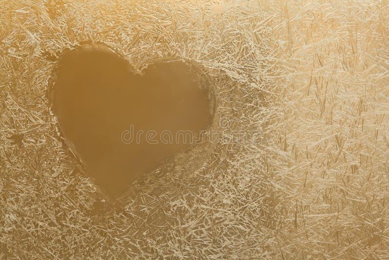 Bevroren hart in glas De Bloemen van het ijs stock foto