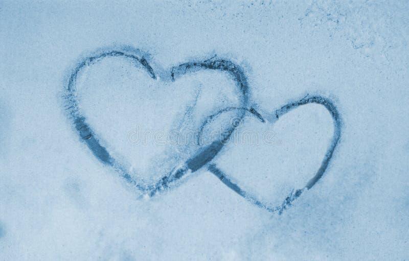 Bevroren venster en harten stock afbeeldingen