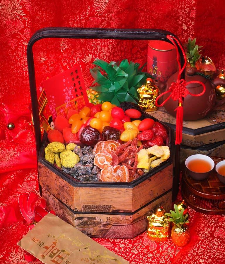 Bewaarde Vruchten Droge vruchten met Chinese nieuwe jaarachtergrond stock afbeeldingen