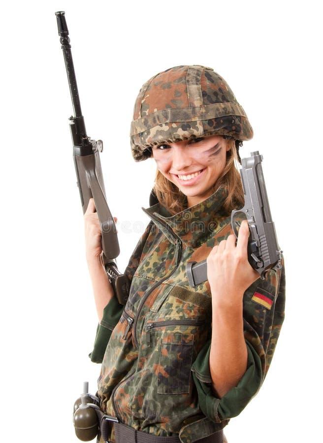 Bewapende militaire vrouw stock fotografie