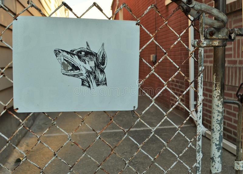 Beware of Dog Sign on Gate Fence House Danger Warning stock photos