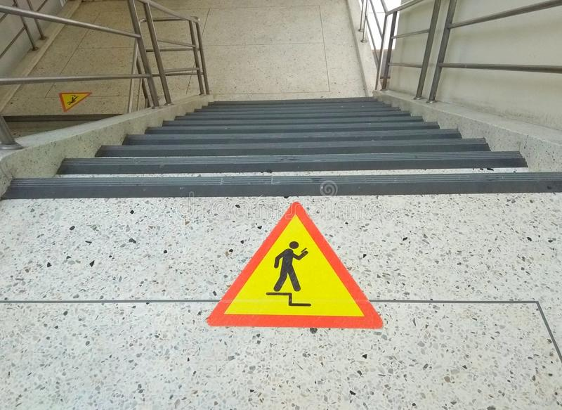 Beware icon on staircase to avoid use mobile phone. Dangerous stock photos