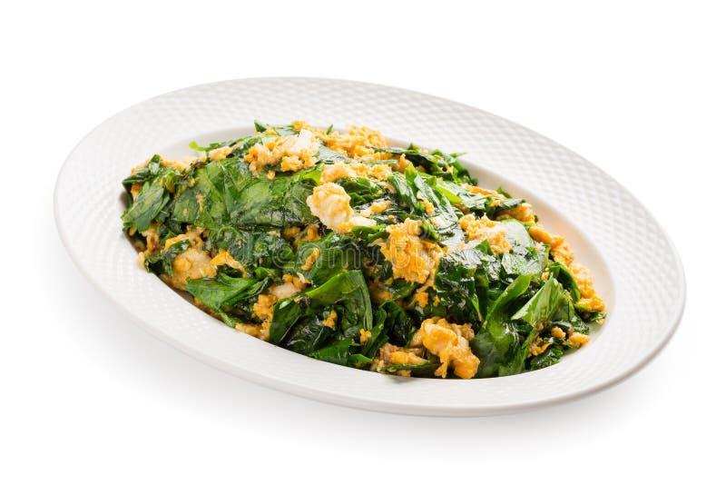 Beweeg gebraden die Gnetum gnemon of melinjo, Liang-groente wordt gebraden met stock foto