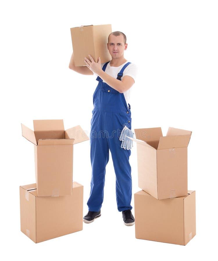 Bewegend dagconcept - jonge mens in blauwe workwear met karton B stock fotografie