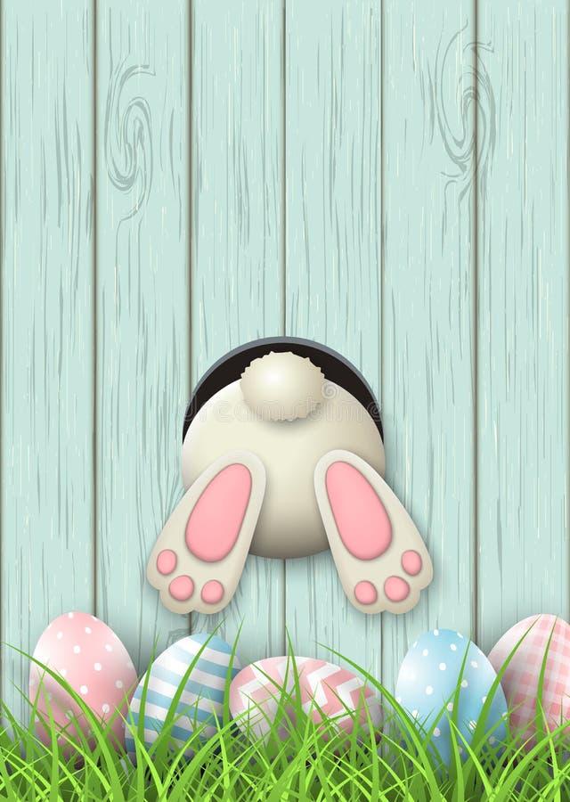 Beweging veroorzakende Pasen, konijntjesbodem en paaseieren in vers gras op blauwe houten achtergrond, illustratie stock illustratie