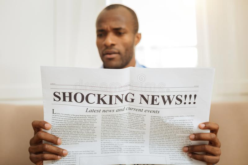 Bewildered man reading shocking news royalty free stock images