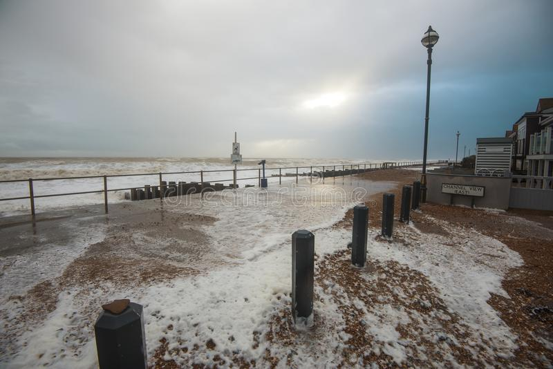 English Channel winter storm throws waves onto the sea front at Bexhill East Sussex, England. Bexhill receives its unfair share of storms and huge waves cast stock photo