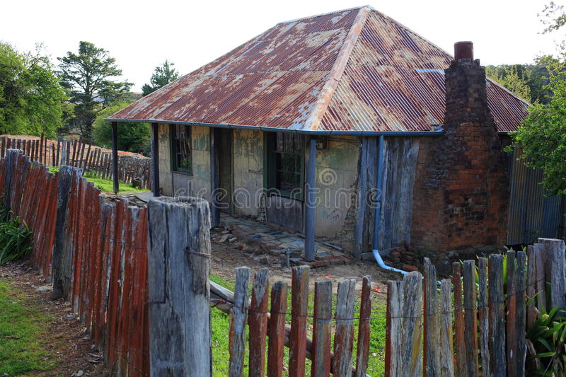 Old building weathered in gold mining town. The highly weathered Beyers Cottage remaining in its original form of the 19th century. Building in the former gold stock image