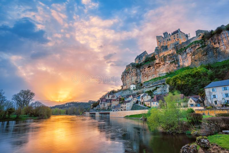 Beynac-et-Cazenac village with medieval Chateau Beynac on dramatic sunset, Dordogne, France stock images
