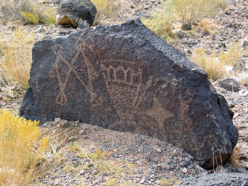 Petroglyph National Monument in New Mexico. Beyond the Rio Grande, Albuquerque is bordered on the west side by a low, barren, volcanic plateau West Mesa - 200 stock image