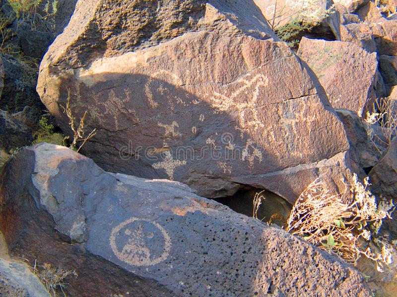 Petroglyph National Monument in New Mexico. Beyond the Rio Grande, Albuquerque is bordered on the west side by a low, barren, volcanic plateau West Mesa - 200 royalty free stock image