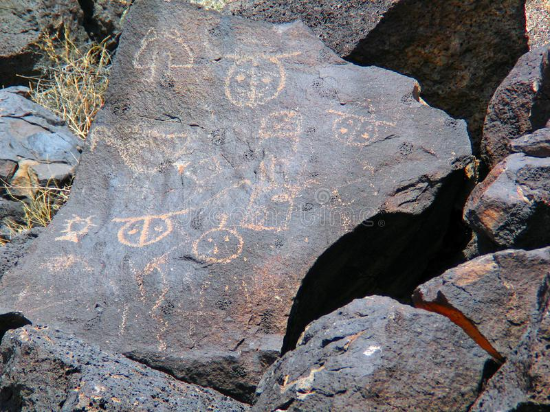Petroglyph National Monument in New Mexico. Beyond the Rio Grande, Albuquerque is bordered on the west side by a low, barren, volcanic plateau West Mesa - 200 royalty free stock photo