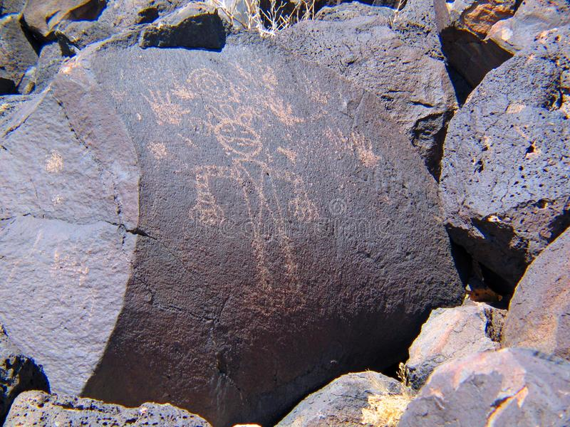 Petroglyph National Monument in New Mexico. Beyond the Rio Grande, Albuquerque is bordered on the west side by a low, barren, volcanic plateau West Mesa - 200 stock photography