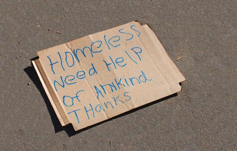 bezdomny podpisuje obraz stock