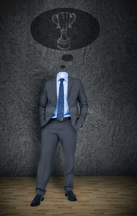 Bezgłowy biznesmen z zwycięzca filiżanką w mowa bąblu zdjęcie stock