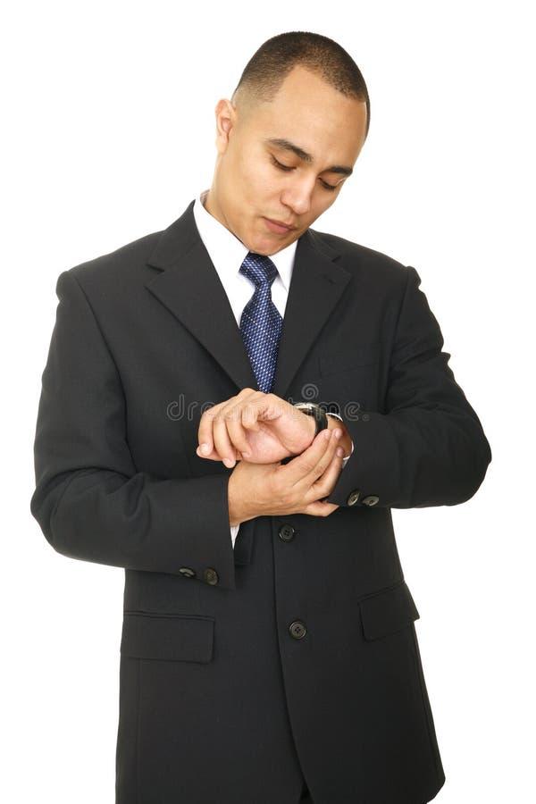 Bezige BedrijfsMens die Horloge bekijkt royalty-vrije stock foto