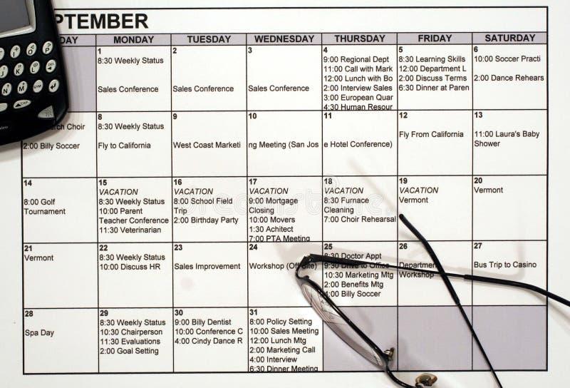 Bezige Kalender, PDA & Glazen royalty-vrije stock foto