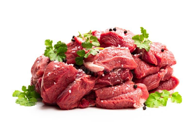 Bezkostny jagnięcy stku mięso z pikantność odizolowywać na bielu fotografia stock