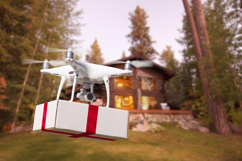 Bezpilotowy samolotu systemu UAV Quadcopter truteń Dostarcza prezent zdjęcie royalty free