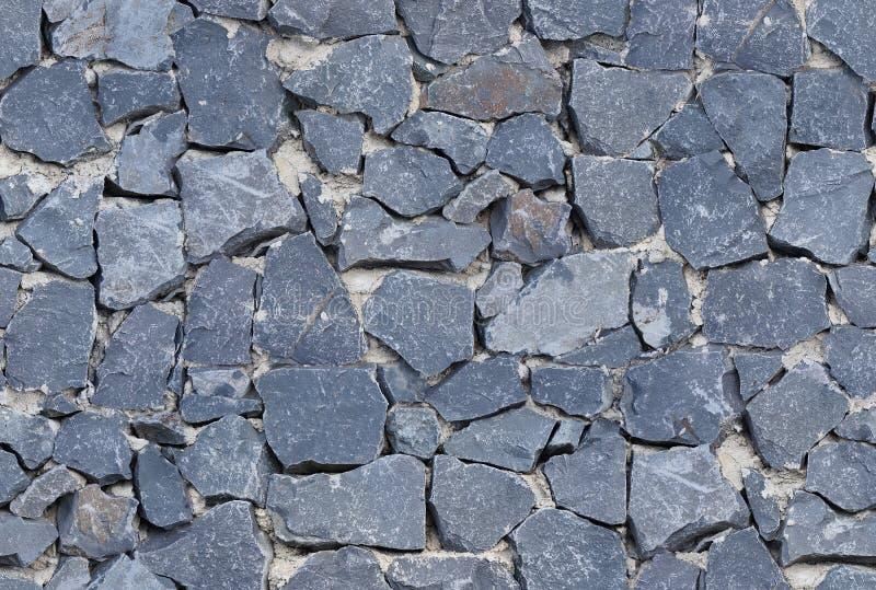 Bezszwowego czarnego ashlar kamiennej ściany stara tekstura fotografia royalty free