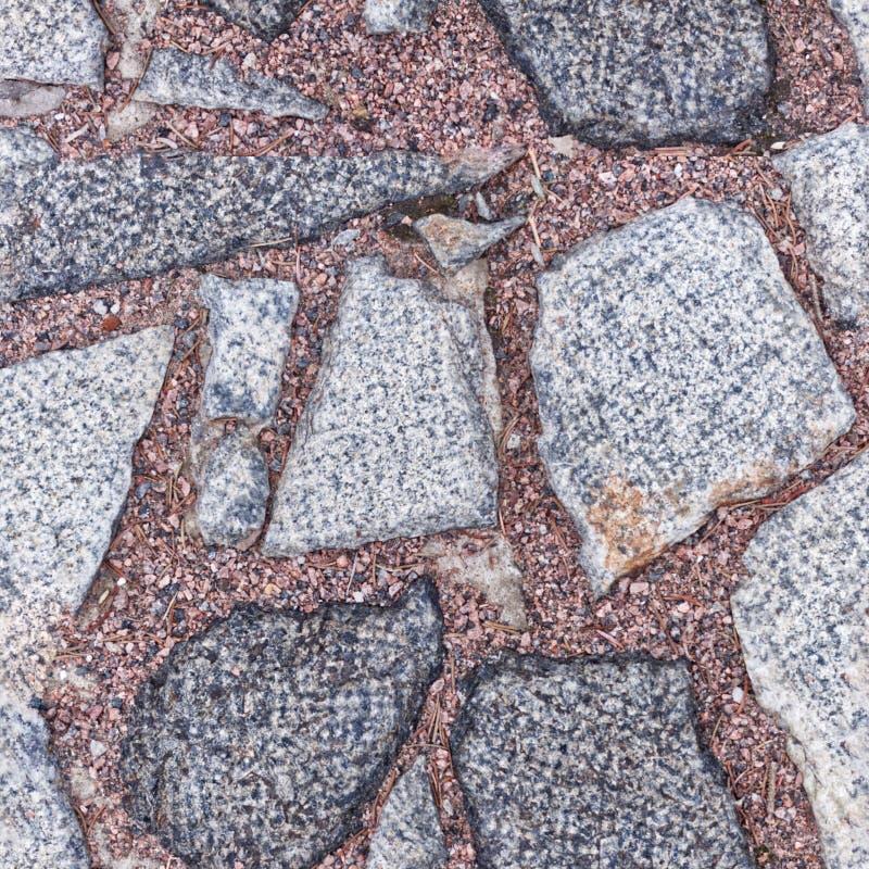 Bezszwowy fotografia wzór czerep kamienny bruk z czerwonymi granitowymi układami scalonymi Ten płytka może używać dla projekt dró fotografia stock