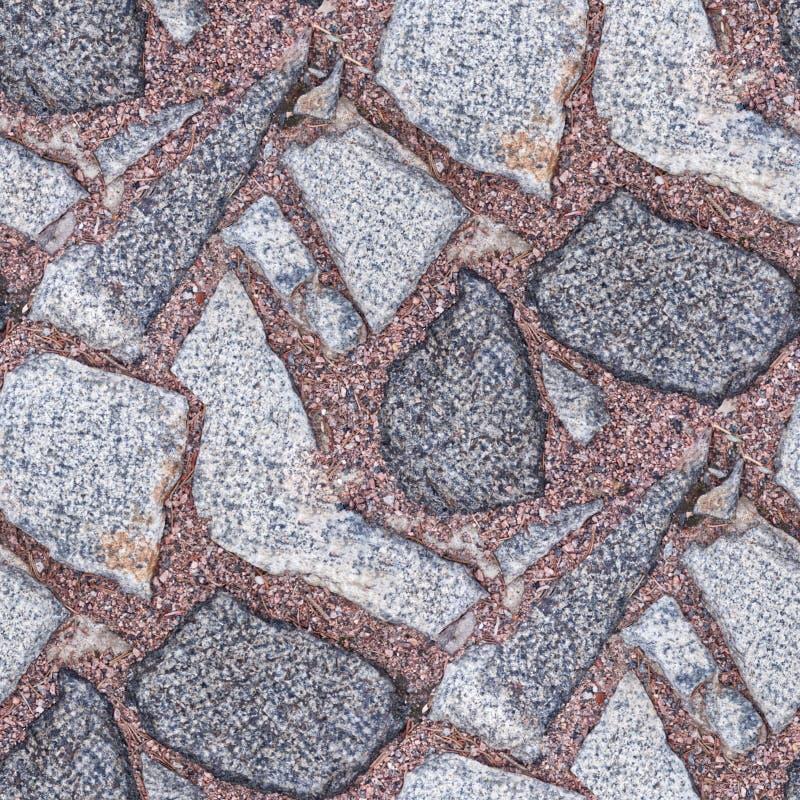 Bezszwowy fotografia wzór czerep kamienny bruk z czerwonymi granitowymi układami scalonymi Ten płytka może używać dla projekt dró obrazy royalty free
