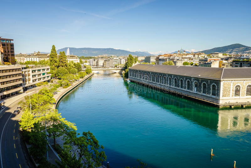 BFM, torre da catedral e Rhone River, Genebra fotos de stock royalty free