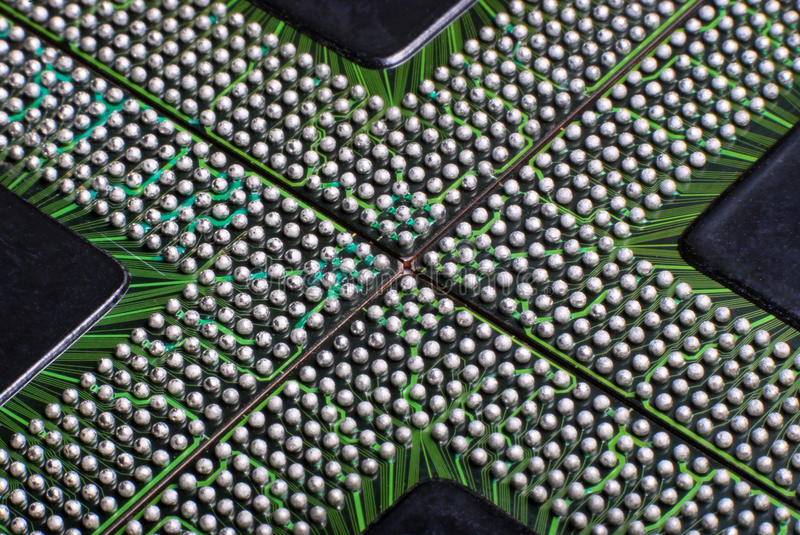 BGA Integrated Circuits. A close up photo taken on the solder balls of ball grid array integrated circuit components stock photography