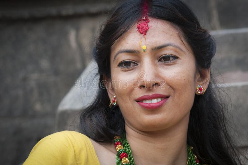 Unidentified Nepalese woman in Bhaktapur, Nepal, listed as a World Heritage by UNESCO for its rich culture and temples royalty free stock photo