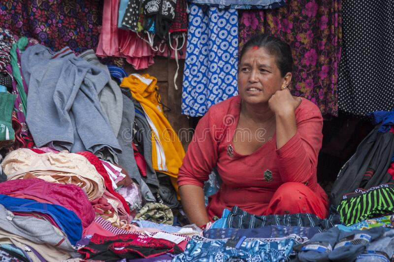 Unidentified Nepalese woman selling clothes in Bhaktapur, Nepal, listed as a World Heritage by UNESCO for its rich culture, temple royalty free stock images
