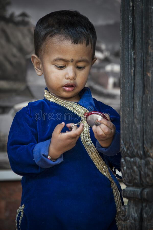 Unidentified Newari Nepalese child playing in Bhaktapur, Nepal, listed as a World Heritage by UNESCO for its rich culture stock photos
