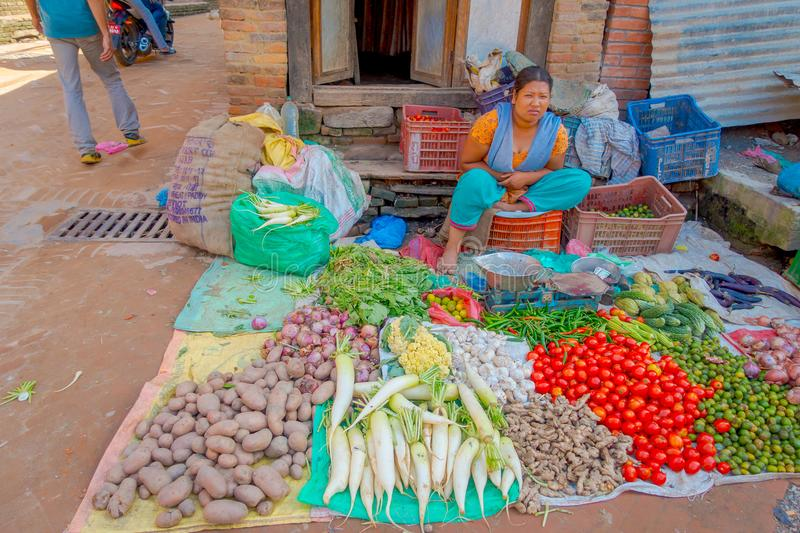 BHAKTAPUR, NEPAL - NOVEMBER 04, 2017: Female street vendor. Vegetables vendor and the owner at Bhaktapur Nepal. In every royalty free stock images